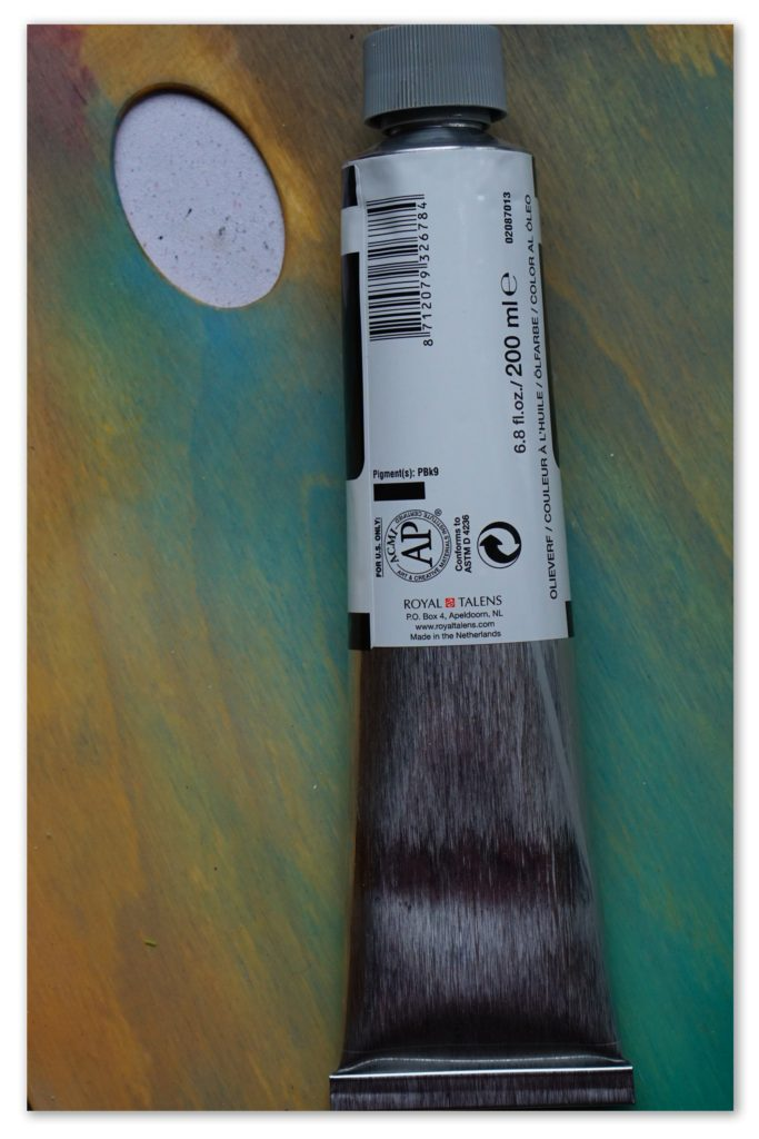 Image of the backside of a tube of Ivory Black van Gogh oil paint