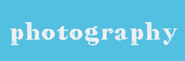 "Blue colored banner with text ""photography"""